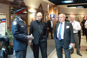 Police board chair Andy Pringle, right, with Chief Mark Saunders and Rev. Brent Hawkes